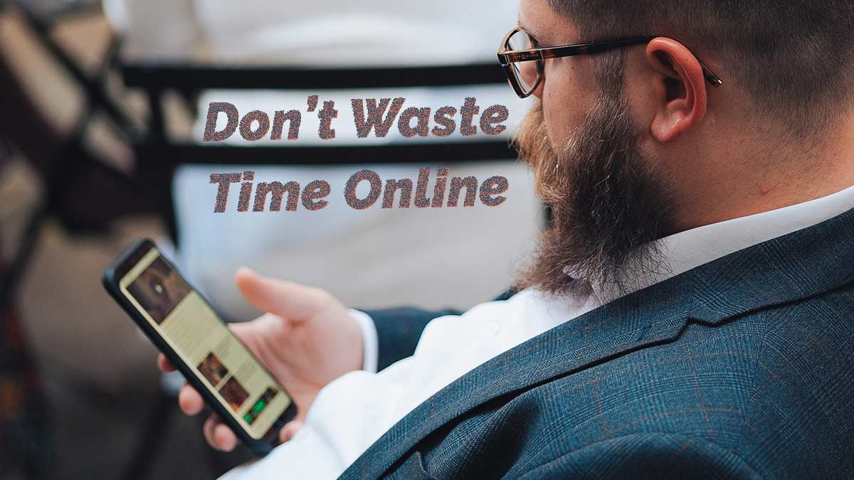 "Guy looking at phone. Words on image say ""Don't Waste Time Online."" The idea is to learn something instead."