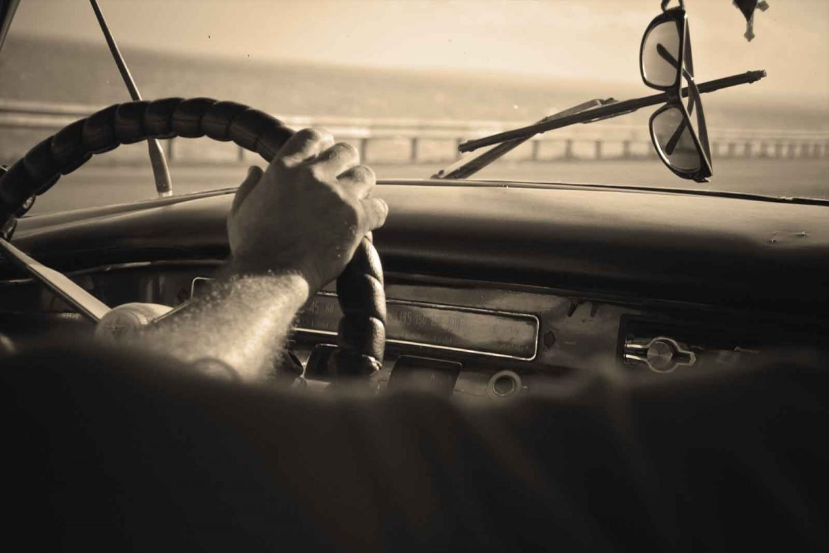 Guy driving a car. Sepia tint. Jason Norris On The Go