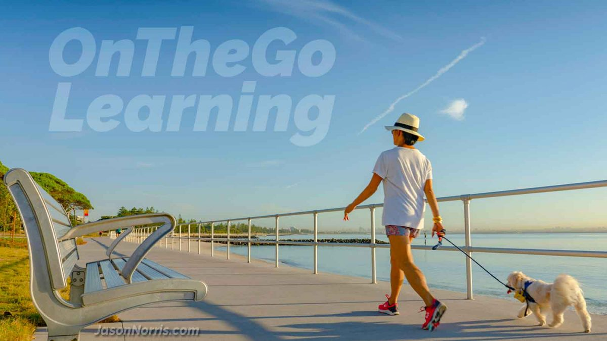 Woman walking her dog, learning on the go. Exploring the concept of on-the-go learning.