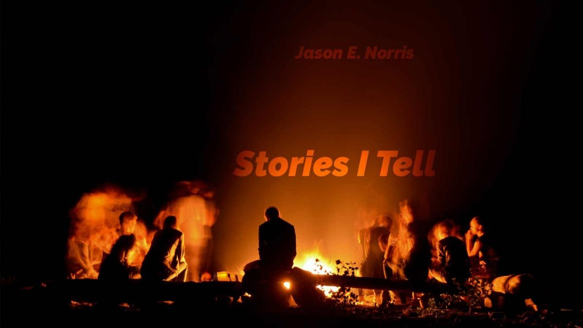 Guy telling stories to friends around the campfire. Stories I Tell by Jason Norris.